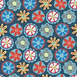 Retro florals seamless vector background. 1960s, 1970s flower design. Red, blue, and yellow doodle flowers on a blue background. Vintage flower pattern for stock illustration