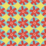 Retro flowers seamless vector background. 1960s, 1970s floral design. Red and blue doodle flowers on a yellow background. Distressed vintage style. For fabric stock illustration
