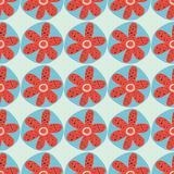 Retro flowers seamless vector background. 1960s, 1970s floral design. Red and blue doodle flowers on a blue background. Distressed. Vintage style. For fabric stock illustration