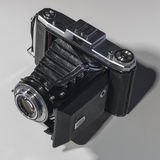 Retro Folding  camera Stock Image
