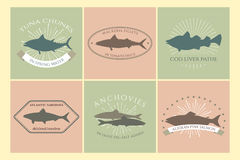 Retro food badges. Set of canned fish labels with fishes silhouettes. Vector collection made in retro style. Logos, badges and design elements. Perfect for food Stock Images