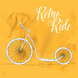 Retro foot bike at aged brown paper. Retro ride Stock Photo