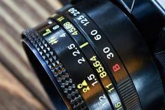 Retro fotokameralins Arkivfoto