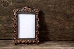 Retro frame for photo on wooden. Background royalty free stock image