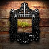 Retro frame on wooden wall Stock Photos