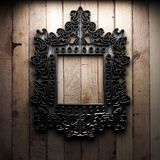 Retro frame on wooden wall Royalty Free Stock Image