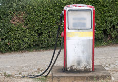 Retro fuel pump. Old style fuel pump on a country road Royalty Free Stock Photos