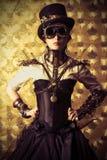 Retro-futurism. Portrait of a beautiful steampunk woman over vintage background stock photos