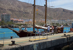 The retro galleon Peter Pan used for tourists fun tours in Teneriffe leaves the quayside at Los Cristianos with crew and passenger. S on board . The passengers Stock Image
