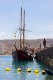 The retro galleon Peter Pan used for tourists fun tours in Teneriffe leaves the quayside at Los Cristianos with crew and passenger. S on board . The passengers Royalty Free Stock Images