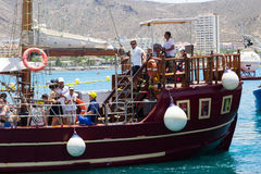 The retro galleon Peter Pan used for tourists fun tours in Teneriffe leaves the quayside at Los Cristianos with crew and passenger. S on board . The passengers Stock Photography