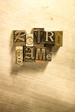 Retro game - Metal letterpress lettering sign. Lead metal  typography text on wooden background Stock Photo