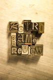 Retro game review - Metal letterpress lettering sign Royalty Free Stock Images