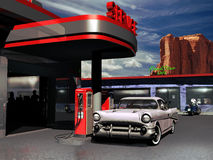Retro gas station. Gas station in the sixties, with a car outside, at the foreground of a road cafe with a motorcycle close to it Stock Image