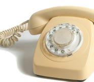 Retro- gelbes Telefon auf weißem Hintergrund Lizenzfreie Stockfotos