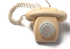 Retro- gelbes Telefon lokalisiert auf weißem Hintergrund Stockbilder