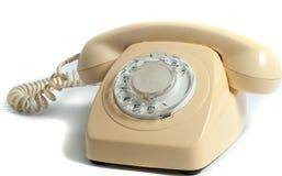 Retro- gelbes Telefon lokalisiert auf weißem Hintergrund Stockfotografie