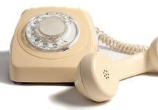 Retro- gelbes Telefon lokalisiert auf weißem Hintergrund Stockfoto