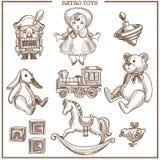 Retro geplaatste de inzamelings vectorhand getrokken geïsoleerde uitstekende pictogrammen van de speelgoedschets stock illustratie