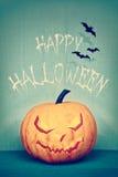 Retro gestileerd beeld van een Halloween-pompoen royalty-vrije stock afbeelding