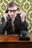 Retro gestore arrabbiato sul telefono Fotografia Stock Libera da Diritti