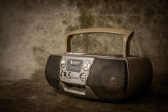 Retro ghetto blaster. The still life retro ghetto blaster on grunge background stock image