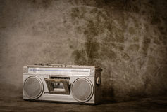 Retro ghetto blaster. The still life retro radio on grunge background royalty free stock images