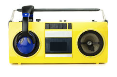 Retro ghetto blaster yellow. With headphones, isolated on white with clipping path Stock Photography
