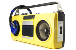 Retro ghetto blaster yellow with headphones. Isolated on white with clipping path Royalty Free Stock Photos