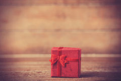 Retro gift on wooden table. Stock Images