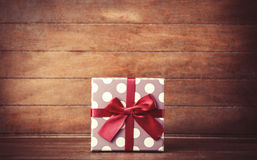 Retro gift on wooden table. Royalty Free Stock Photography