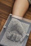 Retro giocattolo del bordo del perno, simbolo del pugno chiuso Fotografie Stock Libere da Diritti