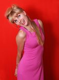 Retro girl. Bright sixties. Portrait of an extravagant blonde on  red background Royalty Free Stock Photos