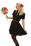 Retro girl with colored candy Stock Photo
