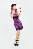 Retro girl with colored hair and candy. Retro girl with colored hair in a purple dress Royalty Free Stock Photo