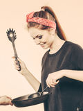 Retro girl cooking and frying on pan. Royalty Free Stock Images