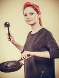 Retro girl cooking and frying on pan. Stock Photos