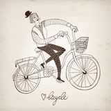 Retro girl cyclist. Retro hand drawn woman on a bicycle on paper background Stock Photography