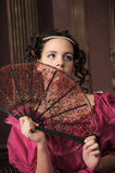 Retro the girl with a fan Stock Photography