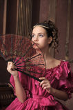Retro the girl with a fan Royalty Free Stock Photos