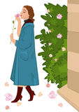 Retro girl with flower near rose bush Stock Image