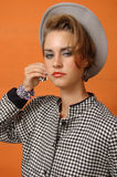 Retro girl in grey cup Stock Photography