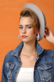 Retro girl in grey cup Royalty Free Stock Photography