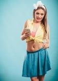 Retro girl hloding phone. Royalty Free Stock Photography