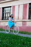 Retro girl on old bike Stock Photo