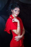 Retro girl in a red dress. Retro girl in a red beautiful dress stock photography