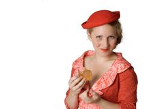 Retro girl with sandwich. Girl in retro dress eating sandwich Stock Image