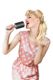 Retro girl singer. Pin-up retro girl singer isolated over white Royalty Free Stock Image