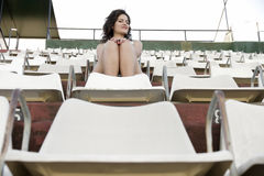 Retro girl sitting in stadium Stock Photography