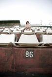 Retro girl sitting in stadium Royalty Free Stock Photos